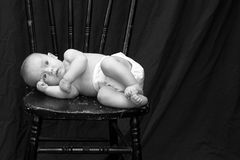 Baby on Chair Royalty Free Stock Image