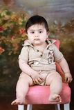 Baby on a chair Royalty Free Stock Photography