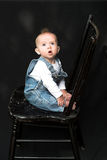 Baby On Chair Stock Photos