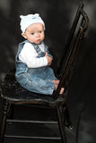 Baby On Chair Stock Photography