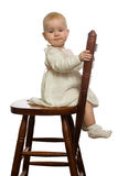 Baby on chair. Baby sit on woden chair Stock Photos