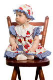 Baby on chair. Baby sit on wooden chair Stock Photography