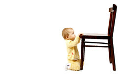 Baby and chair. On white Stock Photo