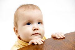 Baby and chair Stock Images