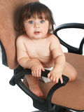 Baby on chair Stock Images