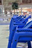 Baby chairs in line in shopping mall Royalty Free Stock Images