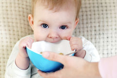Baby champing a bowl Royalty Free Stock Photography