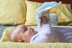 Baby on the changing table with diaper Royalty Free Stock Image