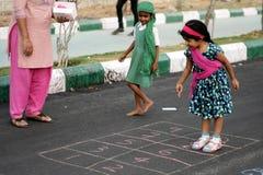 Baby Charumathi,4,Hyderabad Play educational game on the free road program Royalty Free Stock Images
