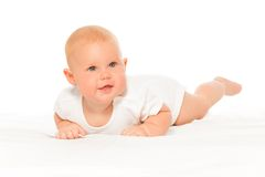 Baby with cheeks in white bodysuit laying alone. Baby with cheeks in white bodysuit on the white background crawling and laying on the blanket Stock Images