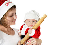 Baby chef cook for christmas. Mother spending Quality time with his baby in the kitchen Royalty Free Stock Images