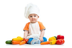 Baby chef with healthy food vegetables royalty free stock photography