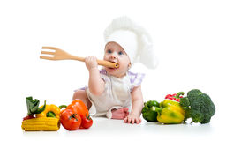 Baby chef with healthy  food vegetables Royalty Free Stock Photos