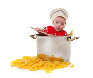Baby chef in a huge Pot with pasta. Cute baby chef in a huge Pot with pasta on white background Royalty Free Stock Photos