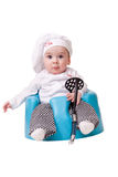 Baby in a chef Outfit. Sitting on a chair holding and holding potato masher Royalty Free Stock Photos