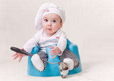 Baby in a chef Outfit. Baby Chef With A Soup ladle wearing cook's outfit Stock Image