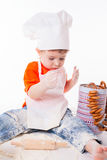 Baby chef sifting flour isolated on white background Stock Photography