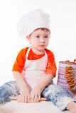 Baby chef sifting flour isolated on white background Royalty Free Stock Image