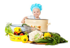 Baby Chef and vegetables Stock Photography