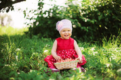 Baby and cherry. Stock Images