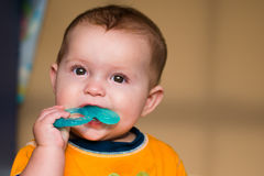 Baby chewing on teething ring Royalty Free Stock Photo
