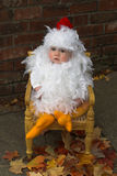 Baby Chick. Image of a cute baby wearing a chicken costume Stock Photos