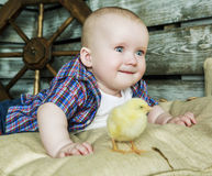 Baby with chicken Stock Photo