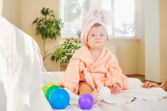 Baby child in the bathrobe and towel on his head after bathing i stock photo