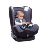 Baby child in car seat playing with toy Royalty Free Stock Photography
