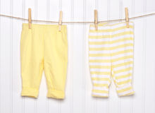 Baby Child Clothing on a Clothesline. Stock Photos