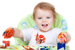 Baby child creates art picture with paints Stock Image