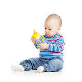 Baby child drinking from bottle. Baby girl child drinking from bottle royalty free stock photos