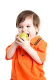 Baby child eating an apple Royalty Free Stock Photography