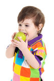 Baby child eating an apple royalty free stock images