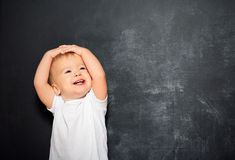 Baby child and empty Blackboard Stock Photo