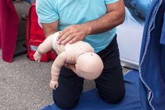 Baby or child first aid training for choking. Child or infant first aid training. Cardiopulmonary resuscitation - CPR Stock Image