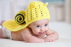 Baby child in funny snail costume Stock Photo