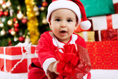 Baby child holding christmas present Royalty Free Stock Photography