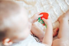 baby child lying on belly weared diaper with teether stock photos