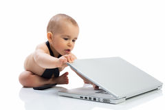 Baby child playing with computer Stock Photography