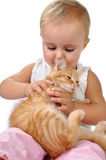 Baby child playing with a kitten Royalty Free Stock Image