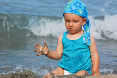 Baby child playing in waves royalty free stock photos