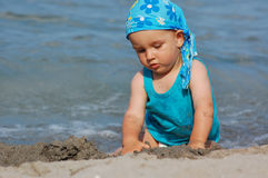 Baby child playing in waves Stock Image