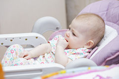 Baby in child seat Stock Photography