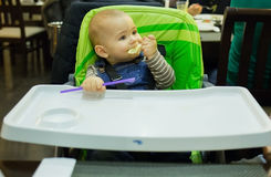 Baby in the child seat at the restaurant Royalty Free Stock Photography