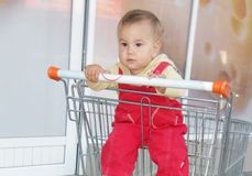 Baby child in shopping cart in supermarket Stock Photo