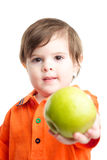 Baby child show with apple Royalty Free Stock Photos