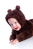 Baby child in teddy-bear costume Stock Images