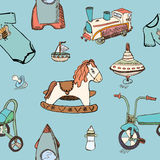 Baby, child toys hand drawn elements seamless pattern. Skeched doodle elements train, bicycle, horse, rocket and toy ship Royalty Free Stock Photo