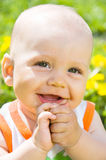 Baby children on the grass. Baby children sitting on the grass in the sun Royalty Free Stock Photos